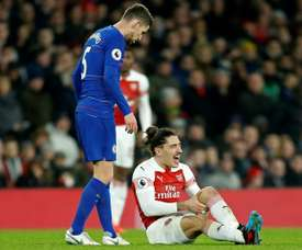 Arsenal defender Hector Bellerin reacts after picking up a knee injury against Chelsea. AFP