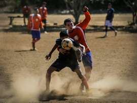 Youth team Titans of Jesus play football against another youth team at the Don Bosco Youth Centre in Managua