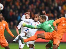 Netherlands goalkeeper Jeroen Zoet attempts to stop a ball kicked by Czechs Theodor Gebre Selassie (CL) during the Euro 2016 qualifying football match at the Amsterdam Arena in Amsterdam, October 13, 2015
