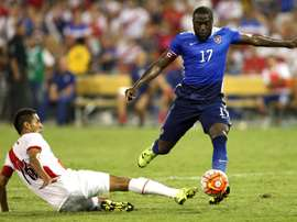 Jozy Altidore of the United States takes the ball past Carlos Lobaton of Peru in the second half during an international friendly at RFK Stadium on September 4, 2015 in Washington, DC