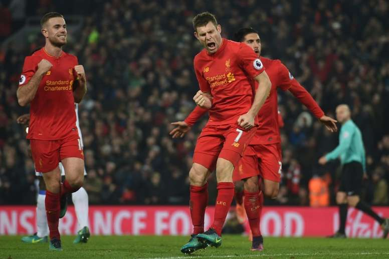Jordan Henderson and team-mates celebrating goals. AFP