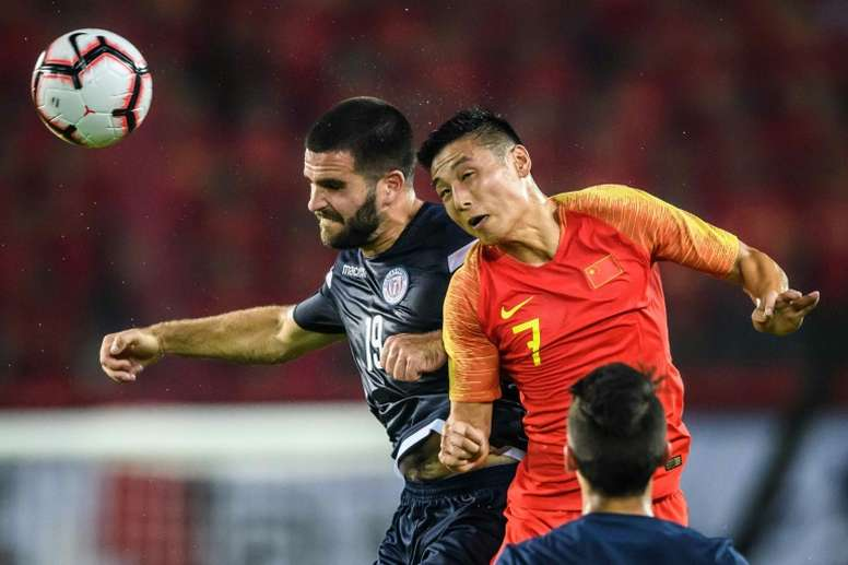 China crush Guam, Aussies beat Nepal in Qatar qualifier. AFP