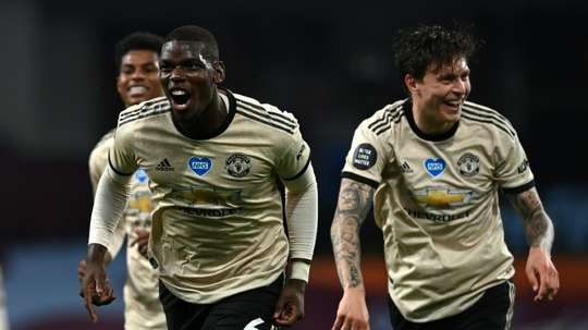 Pogba says the Premier League title is the standard for United. AFP