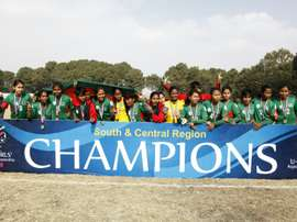 Bangladeshi U-14 girls football players celebrate after winning the AFC regional championship against Nepal in Kathmandu on December 20, 2015