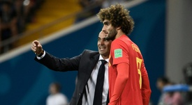 Fellaini hangs up his Belgian boots. AFP