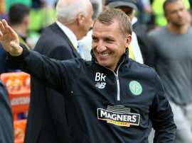 Celtics manager Brendan Rodgers acknowledges supporters ahead of a pre-season match in Dublin, on July 30, 2016
