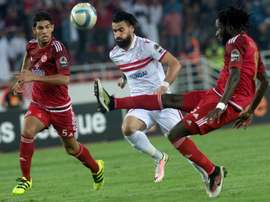 Zamalek Sporting Clubs Hazem Mohammed Abdehamid Emam (white) vies with Wydad Athletic Clubs Amine Atouchi (red) during ta hampions League CAF Semifinal football match on September 24, 2016 in Rabat