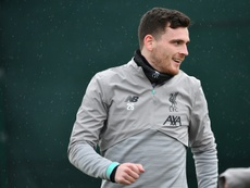 Andy Robertson says there will be no drop-off in the club's motivation. AFP
