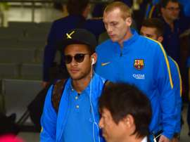 Barcelona forward Neymar (left) arrives in Tokyo for the Club World Cup, on December 14, 2015