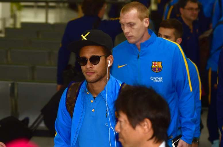 Barcelona forward Neymar (left) arrives in Tokyo for the Club World Cup, on December 14, 2015
