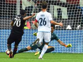 AC Milans Colombian forward Carlos Bacca (L) kicks and scores a goal during the Italian Serie A football match between AC Milan and SS Lazio at the San Siro Stadium in Milan, on September 20, 2016
