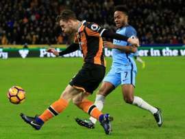 Hull City defender Andrew Robertson (L) vies with Manchester City midfielder Raheem Sterling during the English Premier League football match between Hull City and Manchester City at the KCOM Stadium on December 26, 2016