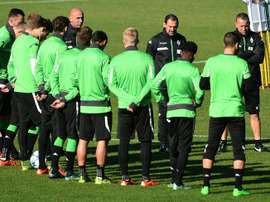 Moenchengladbachs head coach Andre Schubert (6L) speaks during a team training session on the eve of the Group D, first-leg UEFA Champions League football match against Manchester City FC in Moenchengladbach, Germany on September 29, 2015