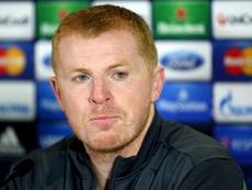 Celtic interim manager Neil Lennon wins title. AFP