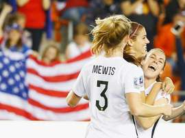 Alex Morgan of the US (C) celebrates with teammates after scoring a goal during their CONCACAF Womens Olympic Qualifying semi-final against Trinidad and Tobago, at BBVA Compass Stadium in Houston, Texas, on February 19, 2016