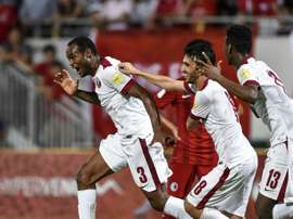 Qatars Abdelkarim Hassan (L) celebrates after scoring a goal during the 2018 World Cup football qualifying match between Qatar and Hong Kong in Hong Kong on September 8, 2015