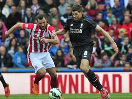 Liverpools English midfielder Steven Gerrard (R) vies with Stoke Citys Dutch defender Erik Pieters during their English Premier League football match in Stoke-on-Trent, England, on May 24, 2015