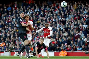 Alexandre Lacazette's superb strike put Arsenal on course for victory against Everton. AFP