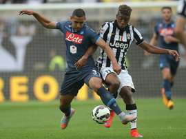 Napolis Algerian defender Faouzi Ghoulam tackles Juventus French midfielder Kingsley Coman in an Italian league match on May 23, 2015 in Turin