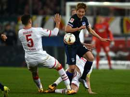 Herthas midfielder Genki Haraguchi and Colognes defender Dominic Maroh vie for the ball during the German first division Bundesliga football match in Cologne, Germany, on February 26, 2016