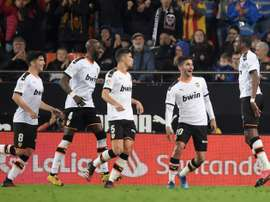 Atletico held at Valencia as Liverpool loom. AFP
