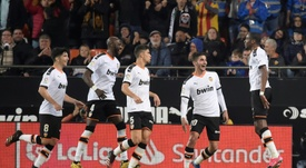 Atletico held at Valencia as Liverpool loom. AFP