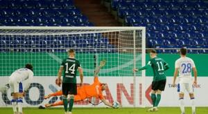 Schalke goalkeeper Ralf Fahrmann (C) saves a penalty from Schweinfurts Amar Suljic. AFP