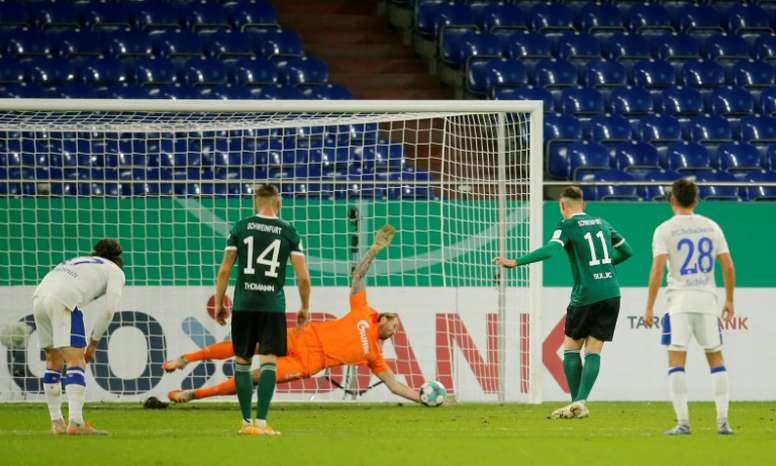 Schalke goalkeeper Ralf Fahrmann (C) saves a penalty from Schweinfurts Amar Suljic. AFP