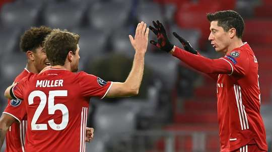 Lewandowski (R) celebrates scoring his 71st Champions League goal. AFP