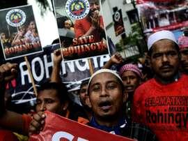 Rohingya Muslim refugees protest against the persecution of Rohingya Muslims in Myanmar, outside the Myanmar Embassy in Kuala Lumpur on November 25, 2016