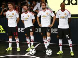 (From L) Manchester Uniteds Ander Herrera, Juan Mata, Daley Blind and Ashley Young pose in the new Adidas away kit at a launch event in London, on August 11, 2015