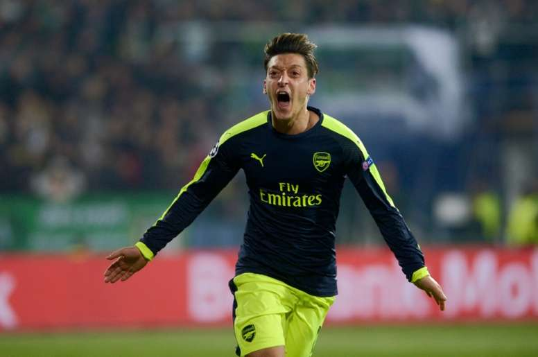 Arsenal's midfielder O–zil celebrates after scoring a goal against PFC Ludogorets. AFP