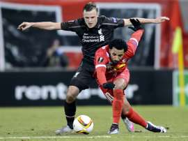 Liverpools defender Brad Smith (L) and Sions midfielder Carlitos fight for the ball during a UEFA Europa League match at the Tourbillon stadium in Sion on December 10, 2015