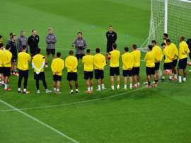 Sevillas players listen to coach Unai Emery during a training session on the eve of the Champions League football match Juventus vs Sevilla FC at the Juventus Stadium  on September 29, 2015 in Turin
