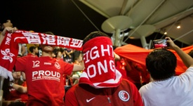 Hong Kong football fans have a history of covering their faces or booing national anthem. AFP