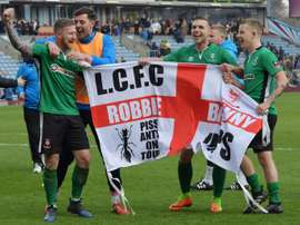 Lincoln City celebrate their FA Cup 5th-round victory against Burnley on Saturday. AFP