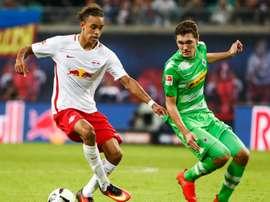 Yurary Poulsen saiu do banco para dar os três pontos ao Leipzig. AFP