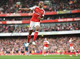 Theo Walcott celebrates after scoring Arsenals second goal against Swansea City at the Emirates Stadium on October 15, 2016