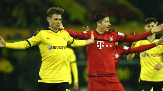 Lewandowski (C) will start against his former club. AFP