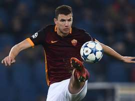 Romas Edin Dzeko, pictured on December 9, 2015, missed a penalty as the Serie A hopefuls lost in the Italian Cup to Spezia