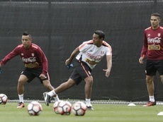 Nolberto Solano (middle) was arrested for not staying in his own home in Peru. AFP
