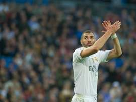 Real Madrids French forward Karim Benzema greets supporters as he leaves the pitch in Madrid on December 5, 2015