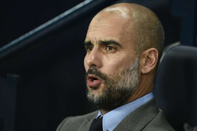 Manchester Citys Spanish manager Pep Guardiola watches during their match against Barcelona. AFP