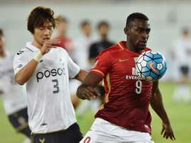 Jackson Martinez of AFC Champions League title-holders Guangzhou Evergrande (right) failed to inspire his side as they drew 0-0 with Pohang Steelers on February 24, 2016