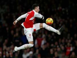 Arsenals midfielder Mesut Ozil has an unsuccessful shot during the English Premier League football match between Arsenal and Bournemouth at the Emirates Stadium in London on December 28, 2015