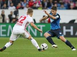 Hoffenheim's Sandro Wagner and Hamburg's Matthias Ostrzolek (L) fight for the ball. AFP