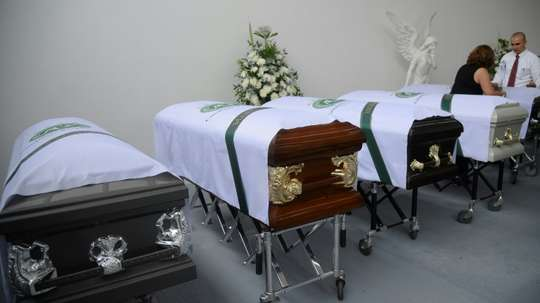 Coffins of members of the Brazilian football team Chapecoense Real the were killed in a plane crash in the Colombian mountains, are seen at the San Vicente mortuary in Medellin on December 1, 2016
