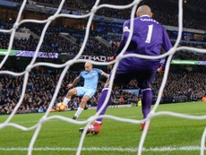 Manchester Citys Pablo Zabaleta (L) scores his teams opening goal against Watford at the Etihad Stadium in Manchester, north west England, on December 14, 2016
