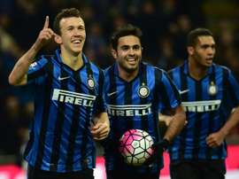 Inter Milans forward Ivan Perisic (L) celebrates after scoring a goal during an Italian Serie A football match against Bologna at the San Siro Stadium in Milan on March 12, 2016