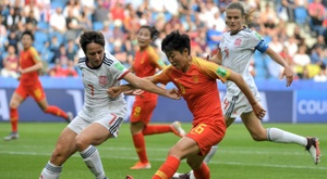 Spain's draw with China saw both teams advance. AFP